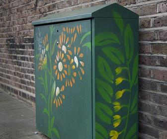 Collective adds stencil art to unsightly telecoms boxes in north London