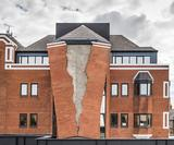Sculptor Alex Chinnecks giant torn brick wall at Assembly London